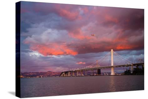 Fiery Clouds and Jet Plane at Bay Bridge, Oakland--Stretched Canvas Print
