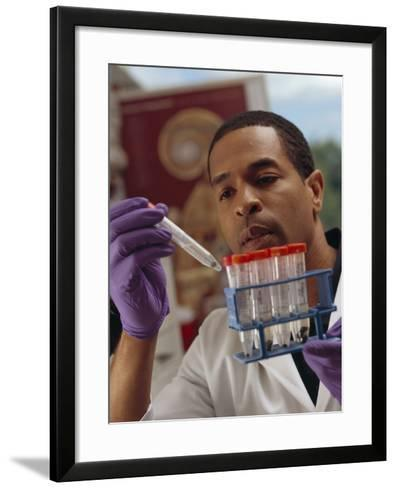 Researcher Looks at a Small Tumor in a Test Tube-Stocktrek Images-Framed Art Print