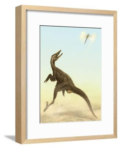 A Small Predatory Sinornithosaurus Jumps at a Dragonfly Flying Above-Stocktrek Images-Framed Art Print