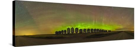 Aurora Borealis Behind Grain Bins on a Country Road in Alberta, Canada-Stocktrek Images-Stretched Canvas Print