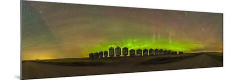 Aurora Borealis Behind Grain Bins on a Country Road in Alberta, Canada-Stocktrek Images-Mounted Photographic Print