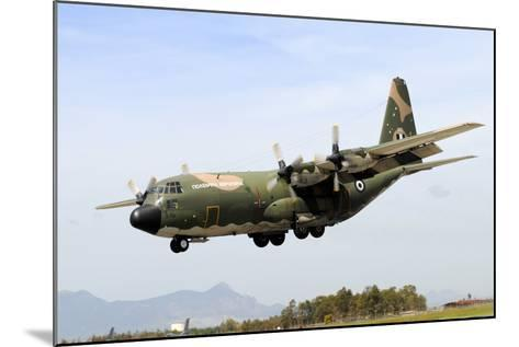 C-130 Hercules from the Hellenic Air Force Landing at Decimomannu Air Base, Italy-Stocktrek Images-Mounted Photographic Print