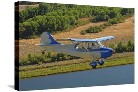 Aeronca 7Ac Champion Aircraft Flying over Chico, California-Stocktrek Images-Stretched Canvas Print