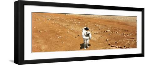Astronaut Looking Up at an Alien Sun That Illuminates the Barren World He Stands On-Stocktrek Images-Framed Art Print