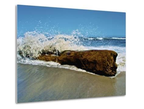 Waves Splashing over Driftwood on Beach-Stocktrek Images-Metal Print