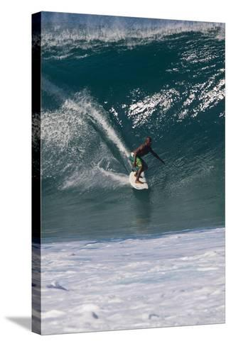 USA, Hawaii, Oahu, Surfers in Action at the Pipeline-Terry Eggers-Stretched Canvas Print