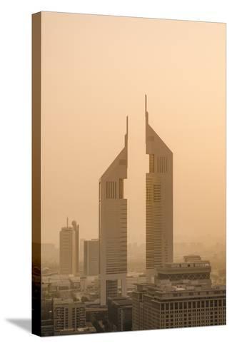 Sunset Engulfs the Jumeirah Emirates Towers Hotel Dubai, Uae-Michael DeFreitas-Stretched Canvas Print