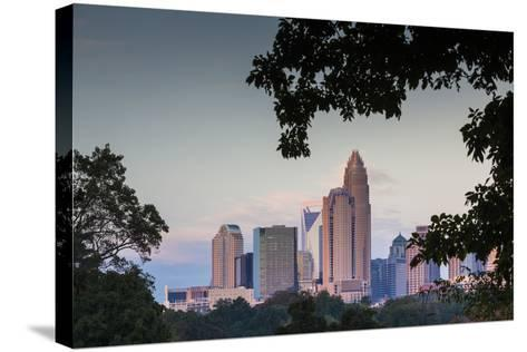 North Carolina, Charlotte, Elevated View of the City Skyline at Dusk-Walter Bibikow-Stretched Canvas Print