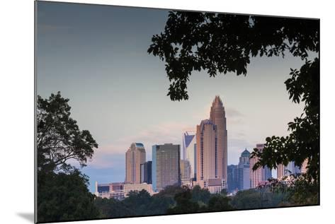 North Carolina, Charlotte, Elevated View of the City Skyline at Dusk-Walter Bibikow-Mounted Photographic Print