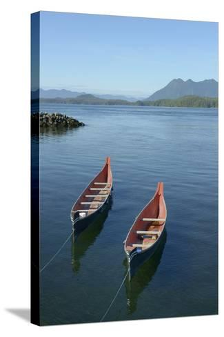 Canada, Vancouver Island. Native Canoes Anchored in Tofino Harbor-Kevin Oke-Stretched Canvas Print