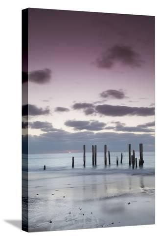 Australia, Fleurieu Peninsula, Port Willunga, Old Jetty, Dusk-Walter Bibikow-Stretched Canvas Print
