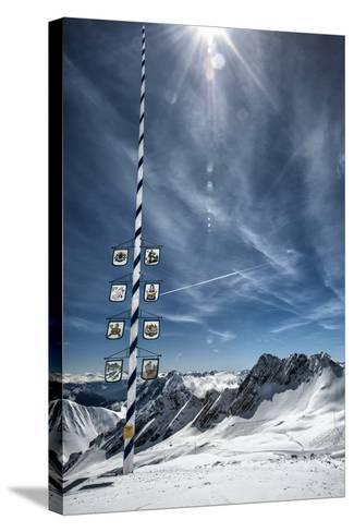 Bavarian Alps, Zugspitze, Germany and Maypole in Winter Vertical-Sheila Haddad-Stretched Canvas Print