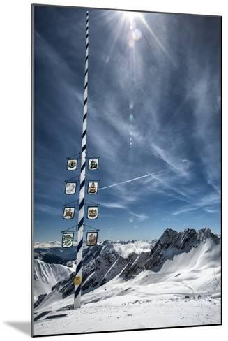 Bavarian Alps, Zugspitze, Germany and Maypole in Winter Vertical-Sheila Haddad-Mounted Photographic Print