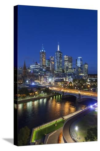Australia, Victoria, Melbourne, Skyline with River and Bridge at Dusk-Walter Bibikow-Stretched Canvas Print