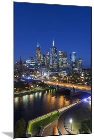 Australia, Victoria, Melbourne, Skyline with River and Bridge at Dusk-Walter Bibikow-Mounted Photographic Print