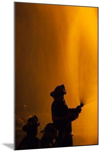 Massachusetts, Cape Ann, Fourth of July Bonfire, Silhouette of Firemen-Walter Bibikow-Mounted Photographic Print