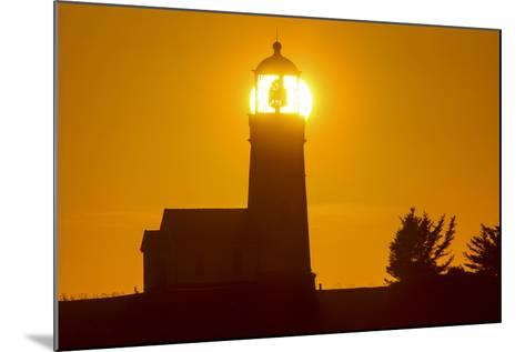 Setting Sun Behind Oregons Oldest Lighthouse at Cape Blanco Sp, Oregon-Chuck Haney-Mounted Photographic Print