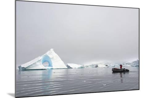 Antarctica. Charlotte Bay. Giant Iceberg with a Hole-Inger Hogstrom-Mounted Photographic Print