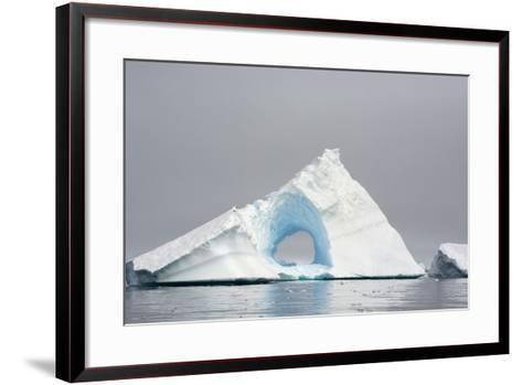 Antarctica. Charlotte Bay. Giant Iceberg with a Hole-Inger Hogstrom-Framed Art Print