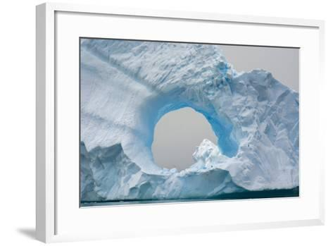 Antarctica. Charlotte Bay. Giant Iceberg with a Hole-Inger Hogstrom-Framed Art Print