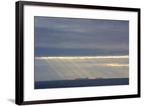 Antarctica. Crepuscular Rays Shining Down onto Tabular Icebergs-Inger Hogstrom-Framed Art Print
