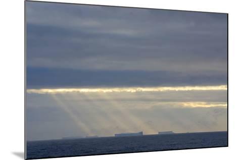 Antarctica. Crepuscular Rays Shining Down onto Tabular Icebergs-Inger Hogstrom-Mounted Photographic Print