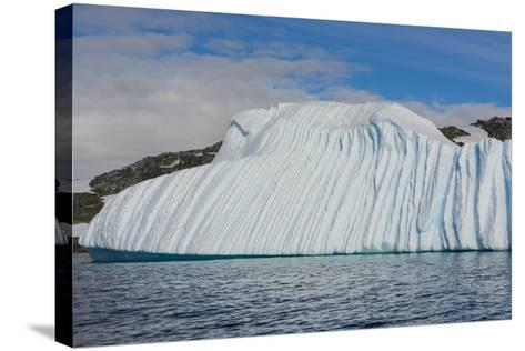 Antarctica. Gerlache Strait. Deeply Grooved Iceberg-Inger Hogstrom-Stretched Canvas Print