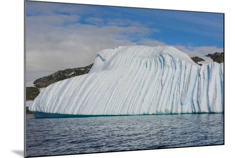 Antarctica. Gerlache Strait. Deeply Grooved Iceberg-Inger Hogstrom-Mounted Photographic Print