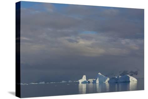 Antarctica. Gerlache Strait. Iceberg and Cloudy Skies-Inger Hogstrom-Stretched Canvas Print