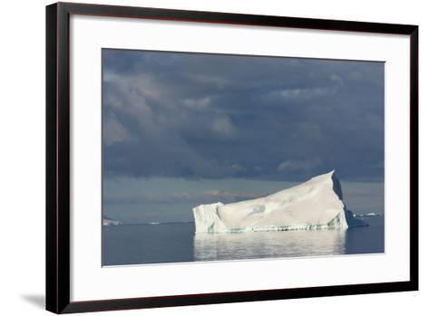 Antarctica. Gerlache Strait. Iceberg and Cloudy Skies-Inger Hogstrom-Framed Art Print