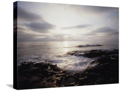 California, San Diego, Sunset Cliffs, a Wave Crashes on a Tide Pool-Christopher Talbot Frank-Stretched Canvas Print