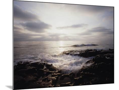 California, San Diego, Sunset Cliffs, a Wave Crashes on a Tide Pool-Christopher Talbot Frank-Mounted Photographic Print