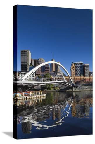 Australia, Victoria, Melbourne, Yarra River Footbridge and Skyline-Walter Bibikow-Stretched Canvas Print