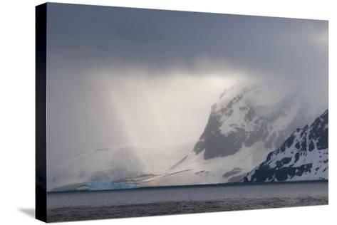 Antarctica. Bransfield Strait. Iceberg under Stormy Skies-Inger Hogstrom-Stretched Canvas Print
