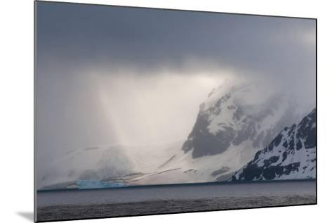 Antarctica. Bransfield Strait. Iceberg under Stormy Skies-Inger Hogstrom-Mounted Photographic Print