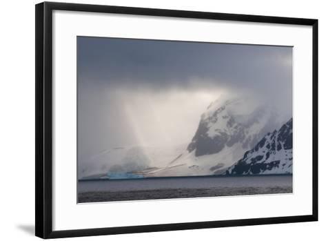 Antarctica. Bransfield Strait. Iceberg under Stormy Skies-Inger Hogstrom-Framed Art Print
