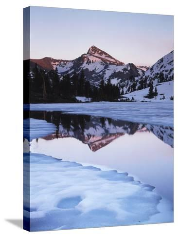 California, Sierra Nevada Mts, Dana Peak Reflecting in a Frozen Lake-Christopher Talbot Frank-Stretched Canvas Print