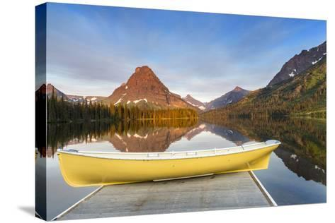 Boat on Calm Morning at Two Medicine Lake in Glacier National Park, Montana-Chuck Haney-Stretched Canvas Print