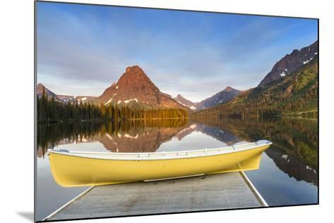 Boat on Calm Morning at Two Medicine Lake in Glacier National Park, Montana-Chuck Haney-Mounted Photographic Print