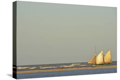 Madagascar, Morondava, Fisherman Boat with Large White Sails at Sea-Anthony Asael-Stretched Canvas Print