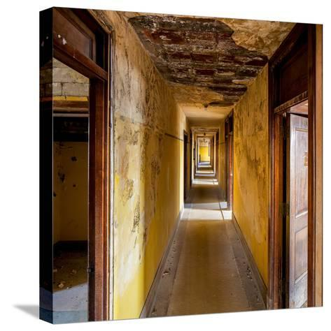Hallway of an Abandoned Building in Butte, Montana-James White-Stretched Canvas Print