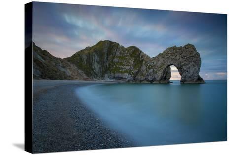 Dawn over Durdle Door Along the Jurassic Coast, Dorset, England-Brian Jannsen-Stretched Canvas Print