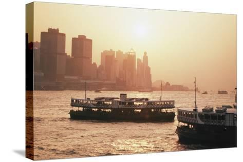 Hong Kong, Tsim Sha Tsui, View of Skyline and Star Ferry-Stuart Westmorland-Stretched Canvas Print