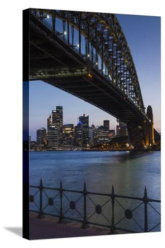 Australia, Sydney Harbor Bridge and Skyline from Milsons Point-Walter Bibikow-Stretched Canvas Print