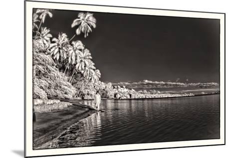 A Woman Walking Along Shoreline in Front of Kapuaiwa Palm Grove, Molokai Island-Richard A. Cooke Iii.-Mounted Photographic Print