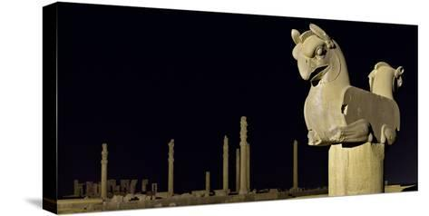 A Griffin Statue, or Homa Bird, with Apadana Palace Columns in the Distance-Babak Tafreshi-Stretched Canvas Print