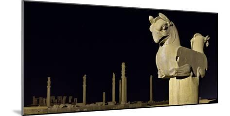 A Griffin Statue, or Homa Bird, with Apadana Palace Columns in the Distance-Babak Tafreshi-Mounted Photographic Print
