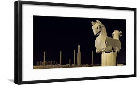 A Griffin Statue, or Homa Bird, with Apadana Palace Columns in the Distance-Babak Tafreshi-Framed Art Print