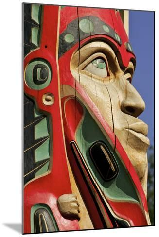Close Up of a Face on a Traditional Haida Totem Carving in Ketchikan, Alaska-Design Pics Inc-Mounted Photographic Print