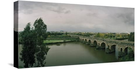 The Puente Roman, an Ancient Roman Bridge over the Guadiana River, and Lusitania Bridge Beyond-Macduff Everton-Stretched Canvas Print